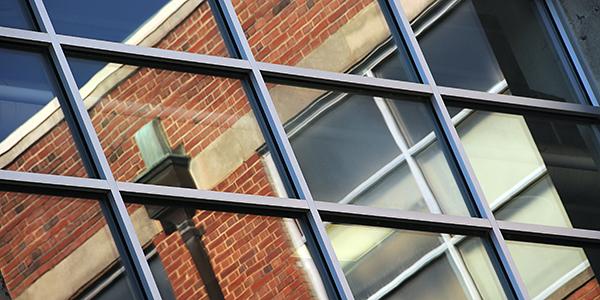 Windows reflect Nelson Hall.