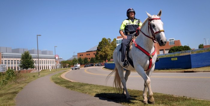Campus police mounted officer patrols Centennial Campus.