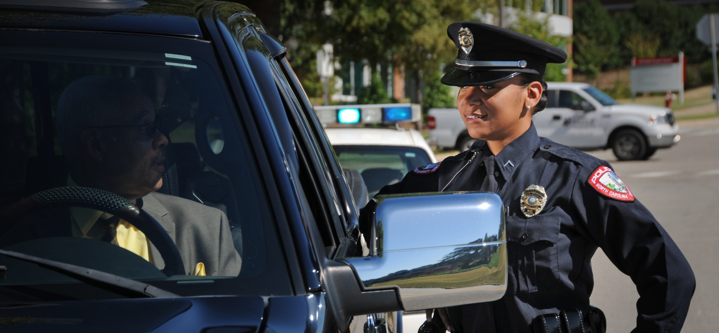 Campus police officer chats with a motorist on Centennial Campus.
