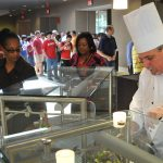 University Dining's executive chef Bill Brizzolara (right) jumps right in on the salad action in Cold Fusion.