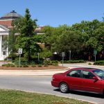 Cars navigate around the traffic circle, past Brooks Hall, on Pullen Road. PHOTO BY ROGER WINSTEAD