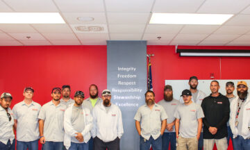 group of Facilities employees standing together